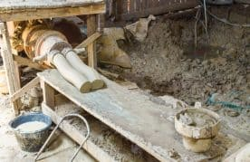 A Picture of a Pug Mill Extruding Clay