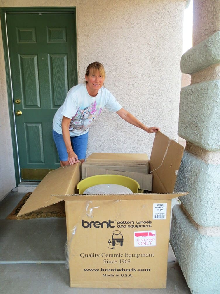 a picture of a pottery wheel delivered to a front door