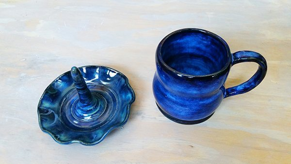 a picture of a glazed fired mug and ring holder