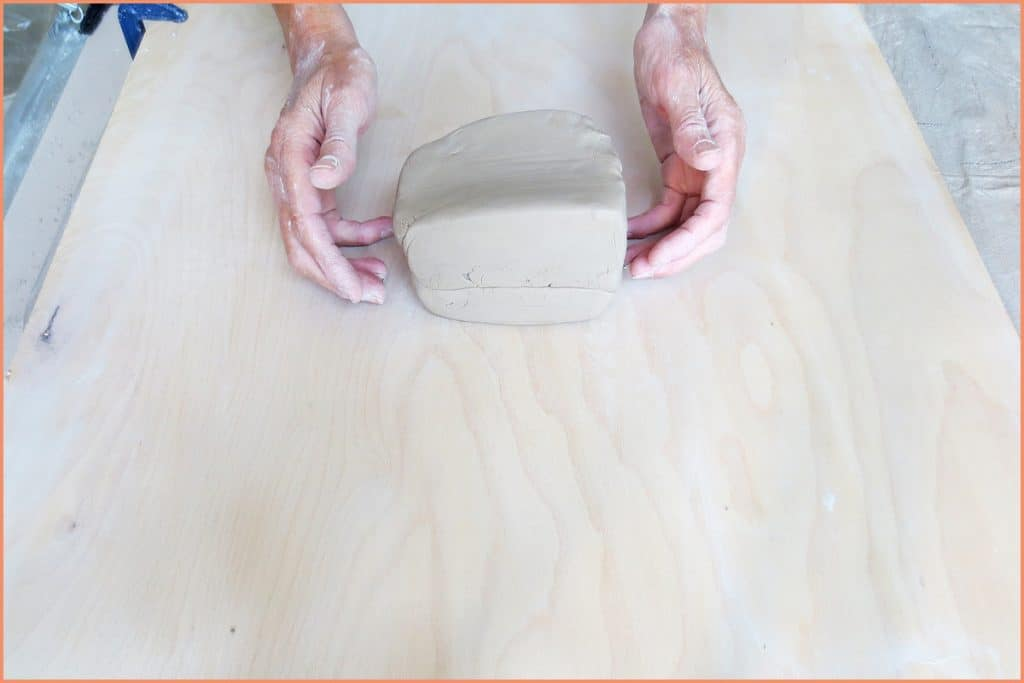 a picture of a potter slamming 2 peices of clay together