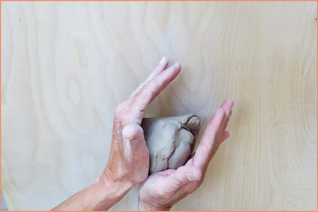 a picture of a potter showing the palms position of the spiral wedge