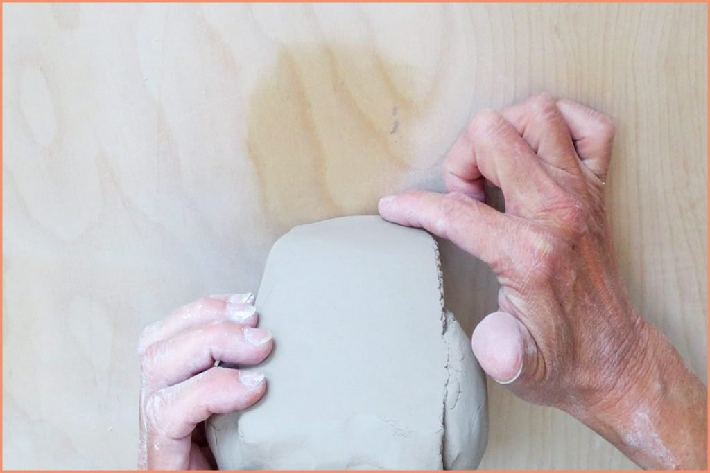 a picture of a potter showing the chin of the ram's head wedge