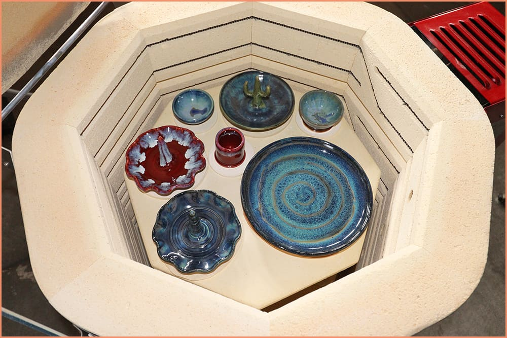 a picture of glazed pottery in kiln