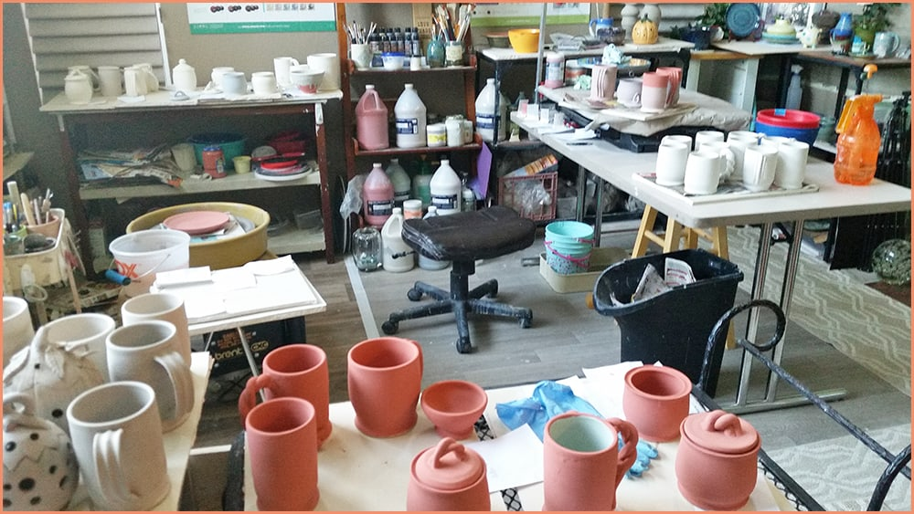 a picture of glazing pottery in the studio