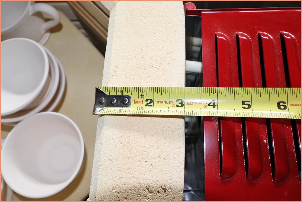 a picture of measuring kiln brick size