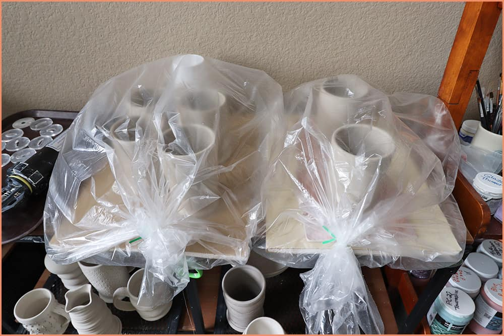 a picture of leather hard pottery in clear plastic bags