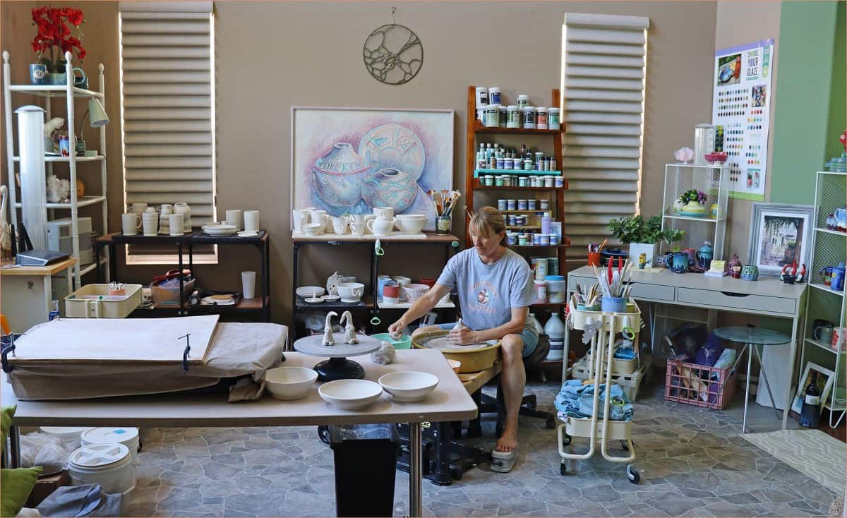 a picture of a potter in a home pottery studio