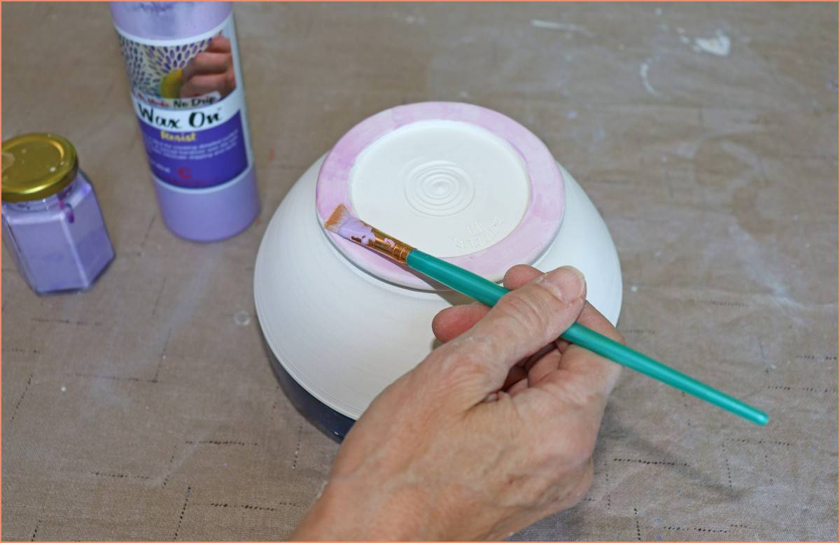 a picture of applying wax to bottom