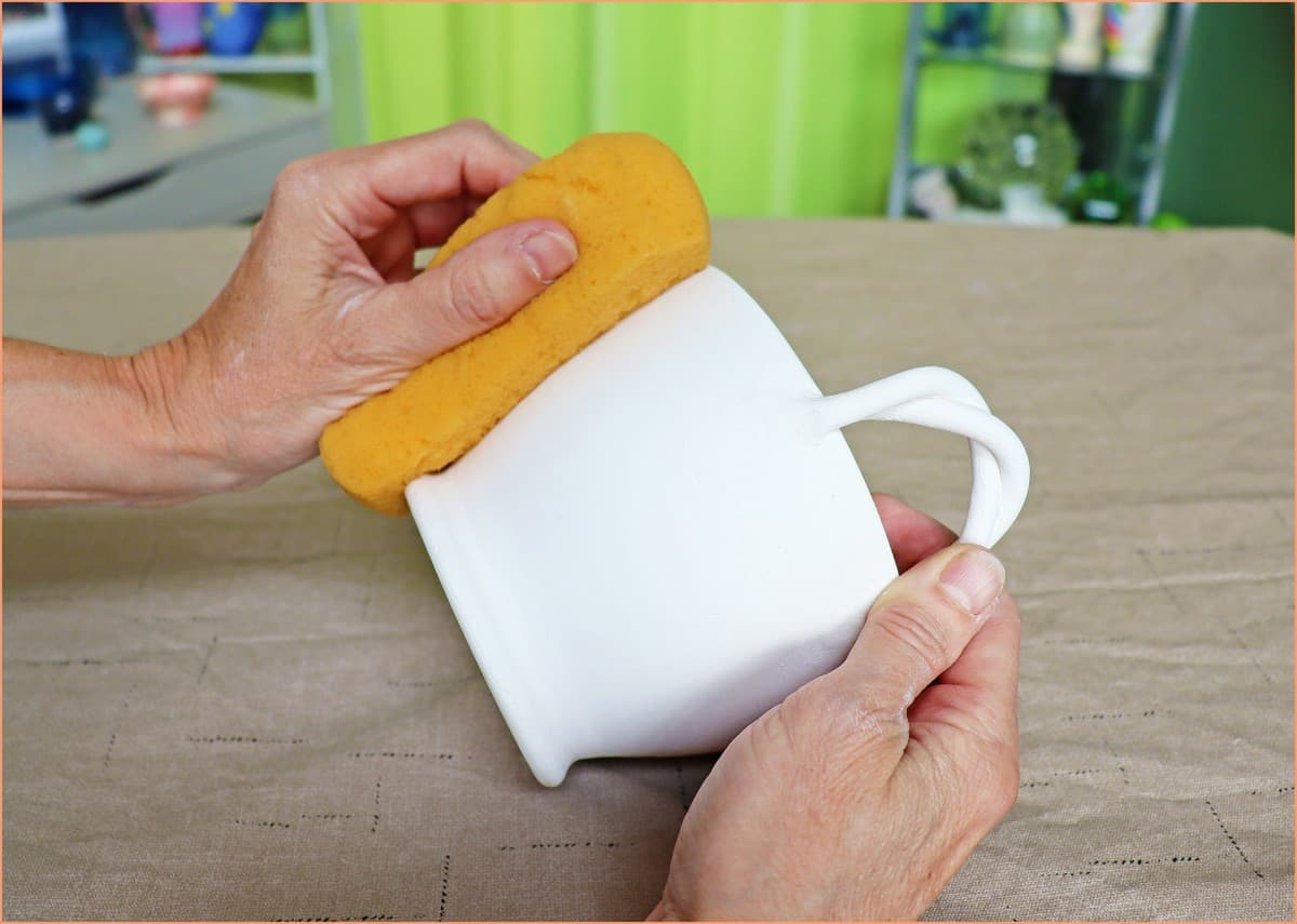 a picture of a potter cleaning bisque ware