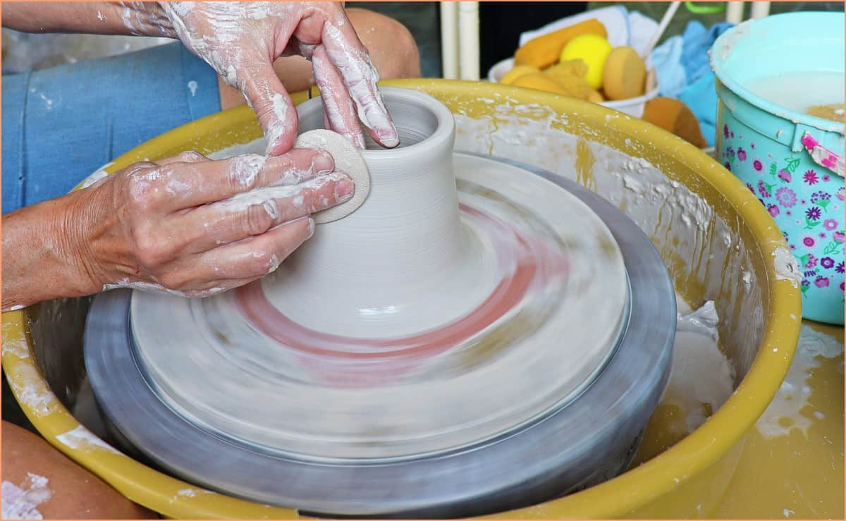 a picture of a potter throwing with a sponge