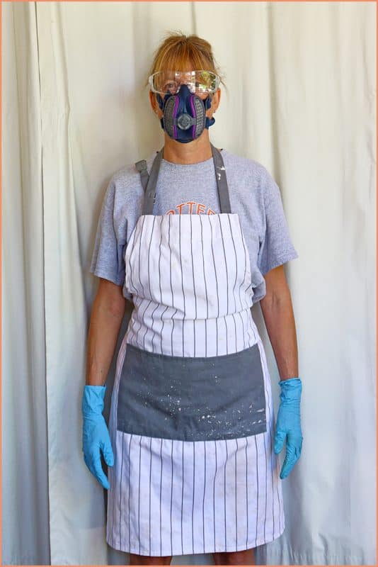 a picture of a potter wearing safety equipment