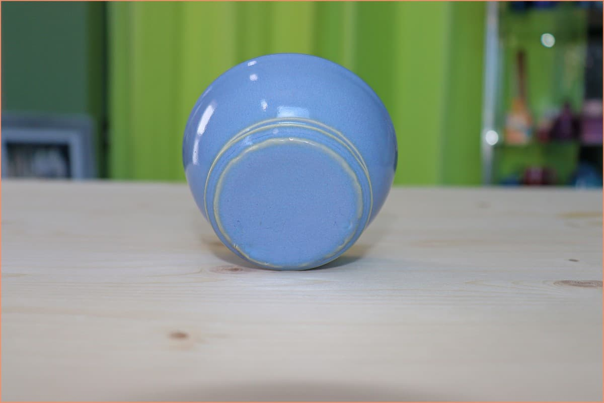 A picture of a bowl glazed on the bottom With Indigo