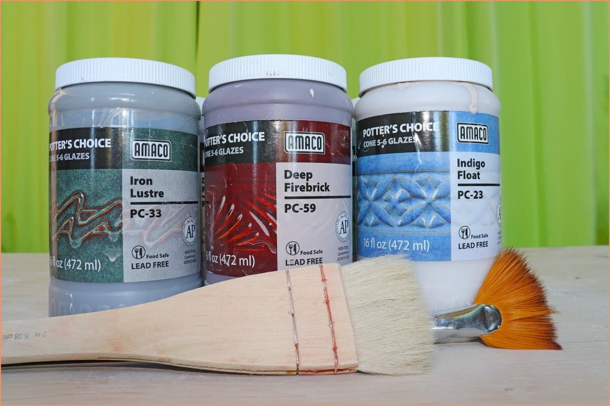 a picture of amaco glaze and brushes
