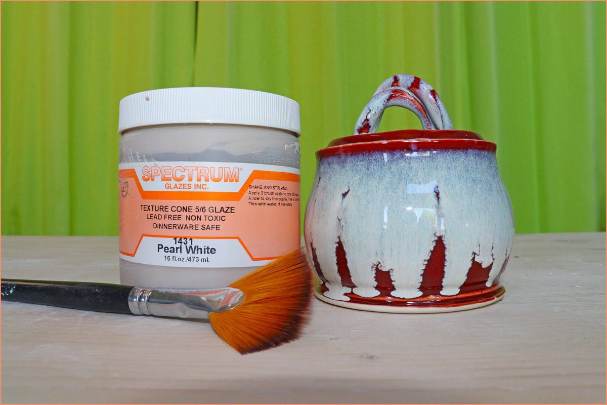 A picture of Spectrum glaze and brush