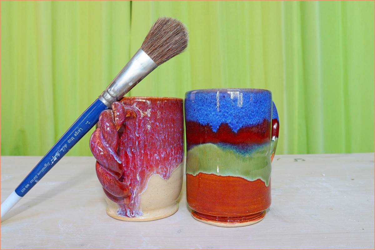 a picture of mugs with brush on glaze