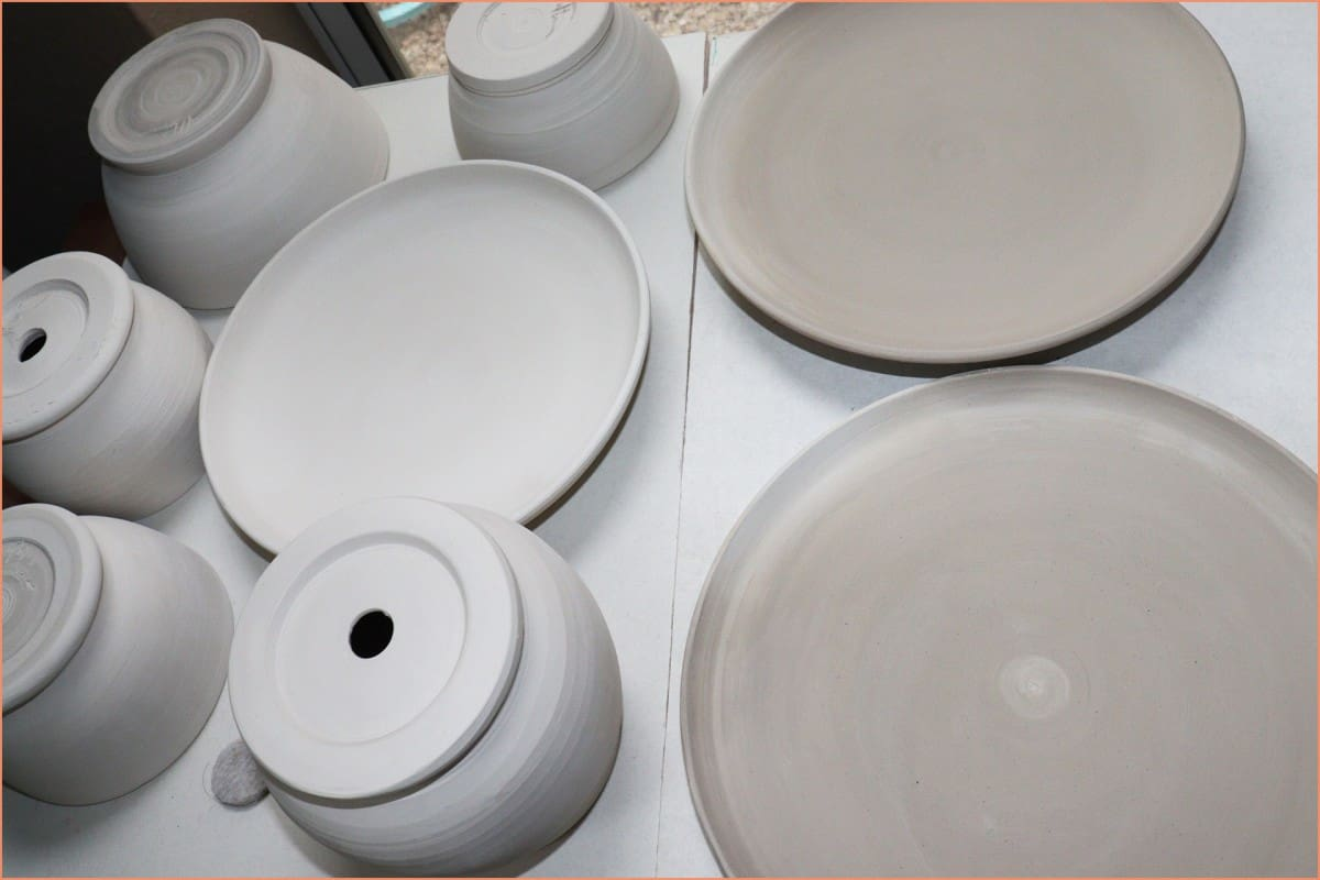 a picture of greenware plates and pots
