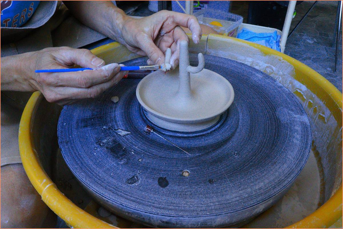 a picture of a potter making a cactus ring holder