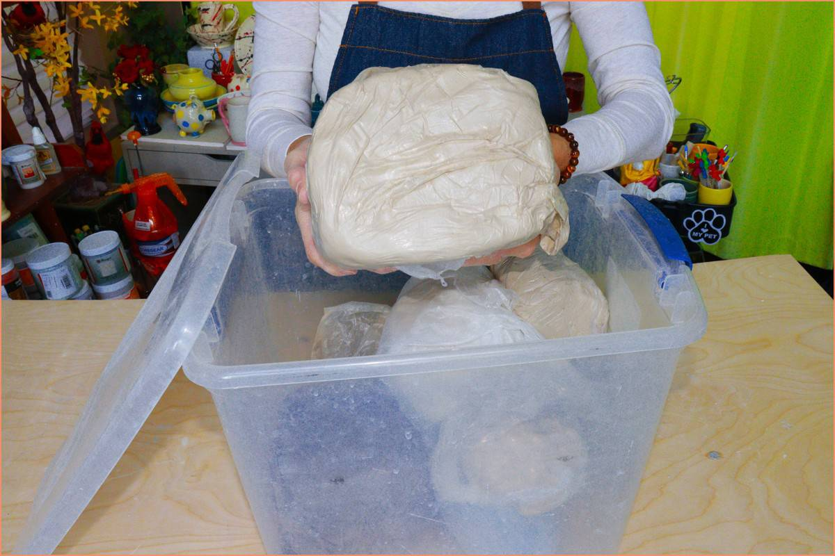 a picture of a potter storing clay