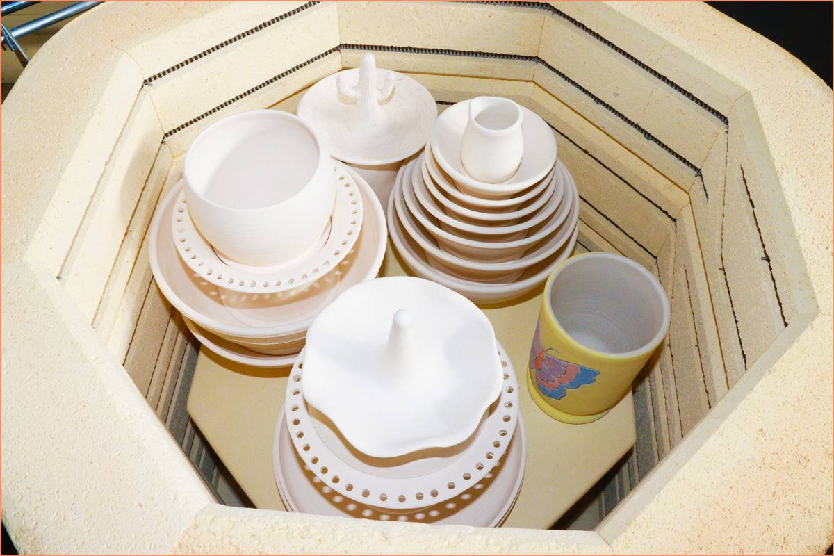 a picture of bisqueware in kiln with underglazed mug