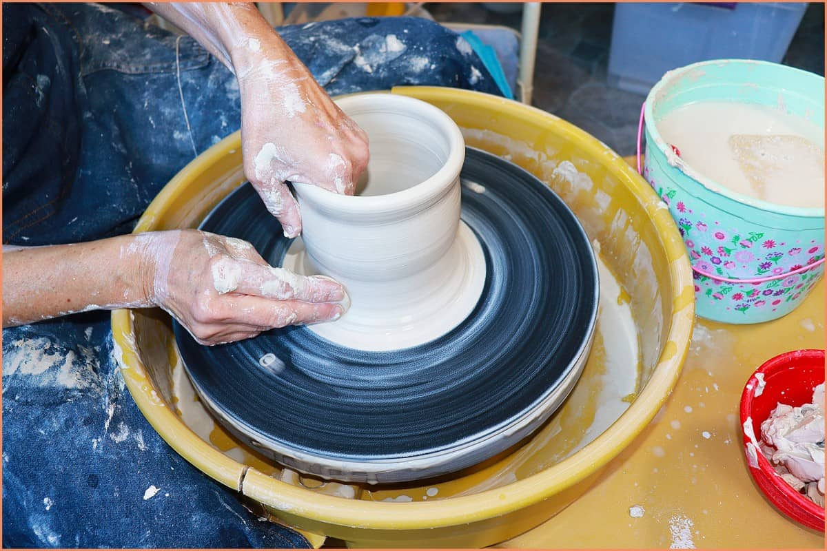 a picture of a potter making mug