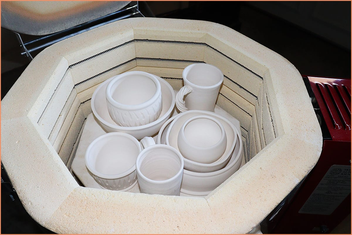 a picture of bisqued pottery in kiln