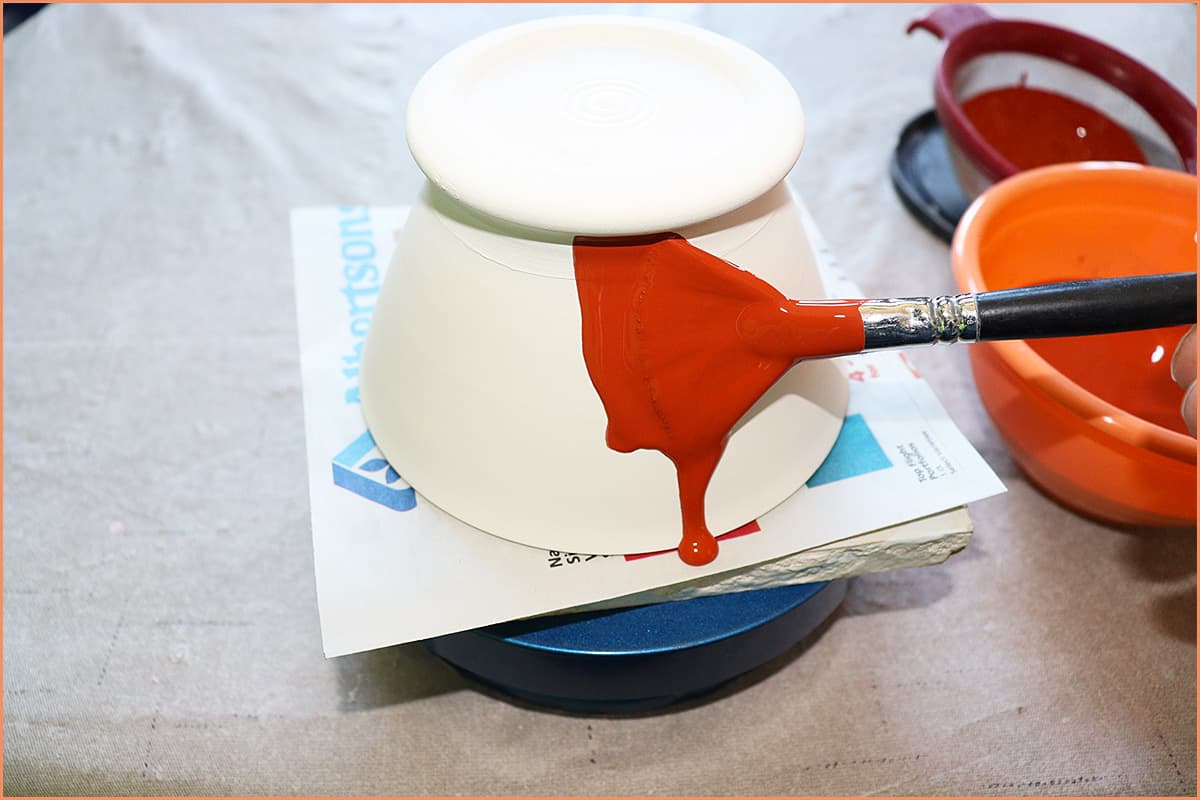 a picture of greenware being glazed